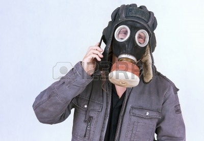 5757115-businessman-dress-a-gas-mask-now-inconveniently-to-speak-on-the-phone.jpg
